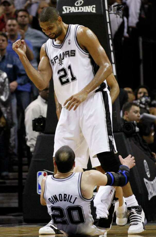 SPURS -- San Antonio Spurs forward Tim Duncan (21) shares a moment with San Antonio Spurs guard Manu Ginobili (20) during overtime of game five of the Western Conference First Round at AT&T Center, Wednesday, April 27, 2011.  The Spurs won 110-103.  JERRY LARA/glara@express-news.net Photo: JERRY LARA, San Antonio Express-News / SAN ANTONIO EXPRESS-NEWS (NFS)