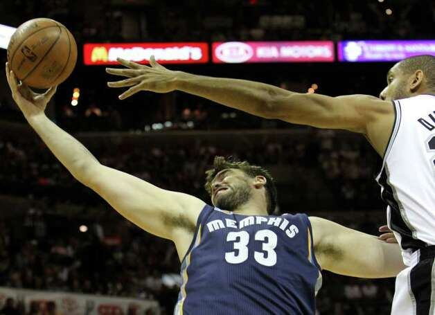 Memphis Grizzlies center Marc Gasol (33) struggles for control of the ball against San Antonio Spurs forward Tim Duncan (21)  in Game 5 of the first round of the Western Conference playoff at the AT&T Center on Wednesday, April 27, 2011. Kin Man Hui/kmhui@express-news.net Photo: KIN MAN HUI, Kin Man Hui/kmhui@express-news.net / San Antonio Express-News NFS