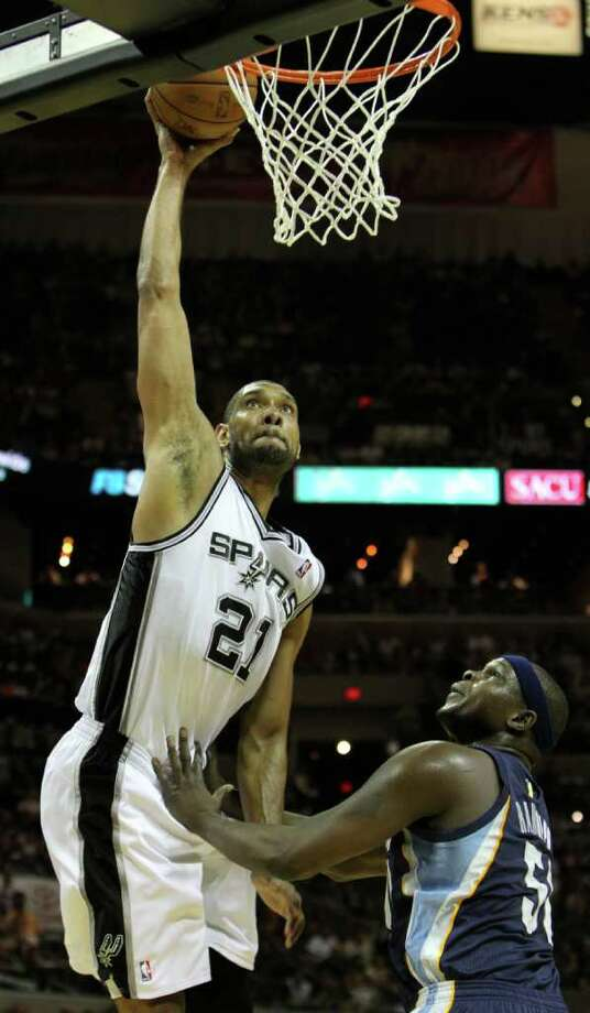 San Antonio Spurs forward Tim Duncan (21) attempts a dunk against  Memphis Grizzlies forward Zach Randolph (50) in Game 5 of the first round of the Western Conference playoff at the AT&T Center on Wednesday, April 27, 2011. Kin Man Hui/kmhui@express-news.net Photo: KIN MAN HUI, Kin Man Hui/kmhui@express-news.net / San Antonio Express-News NFS