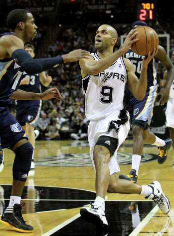 San Antonio Spurs guard Tony Parker (9) drives against  Memphis Grizzlies guard Mike Conley (11) in Game 5 of the first round of the Western Conference playoff at the AT&T Center on Wednesday, April 27, 2011. Kin Man Hui/kmhui@express-news.net Photo: KIN MAN HUI, Kin Man Hui/kmhui@express-news.net / San Antonio Express-News NFS