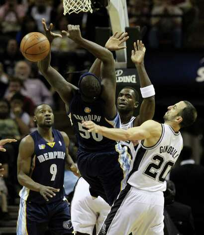 Memphis Grizzlies forward Zach Randolph (50) can't control the ball near  Memphis Grizzlies guard Tony Allen (9), San Antonio Spurs forward Antonio McDyess (34) and San Antonio Spurs guard Manu Ginobili (20) in Game 5 of the first round of the Western Conference playoff at the AT&T Center on Wednesday, April 27, 2011. Kin Man Hui/kmhui@express-news.net Photo: KIN MAN HUI, Kin Man Hui/kmhui@express-news.net / San Antonio Express-News NFS
