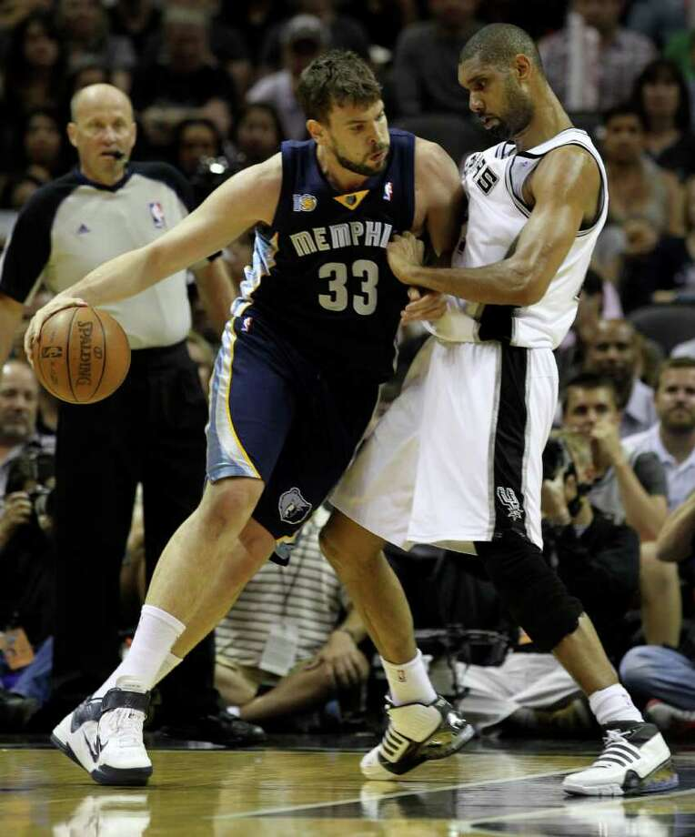 Memphis Grizzlies center Marc Gasol (33) drives against San Antonio Spurs forward Tim Duncan (21) in Game 5 of the first round of the Western Conference playoff at the AT&T Center on Wednesday, April 27, 2011. Kin Man Hui/kmhui@express-news.net Photo: KIN MAN HUI, Kin Man Hui/kmhui@express-news.net / San Antonio Express-News NFS