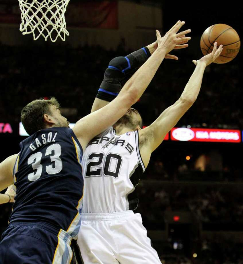 Memphis Grizzlies center Marc Gasol (33) makes contact with San Antonio Spurs guard Manu Ginobili (20) in Game 5 of the first round of the Western Conference playoff at the AT&T Center on Wednesday, April 27, 2011. Kin Man Hui/kmhui@express-news.net Photo: KIN MAN HUI, Kin Man Hui/kmhui@express-news.net / San Antonio Express-News NFS
