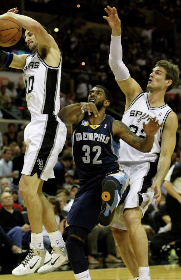 San Antonio Spurs guard Manu Ginobili (20) tries to control the ball against  Memphis Grizzlies guard O.J. Mayo (32) and San Antonio Spurs forward Tiago Splitter (22)  in Game 5 of the first round of the Western Conference playoff at the AT&T Center on Wednesday, April 27, 2011. Kin Man Hui/kmhui@express-news.net Photo: KIN MAN HUI, Kin Man Hui/kmhui@express-news.net / San Antonio Express-News NFS