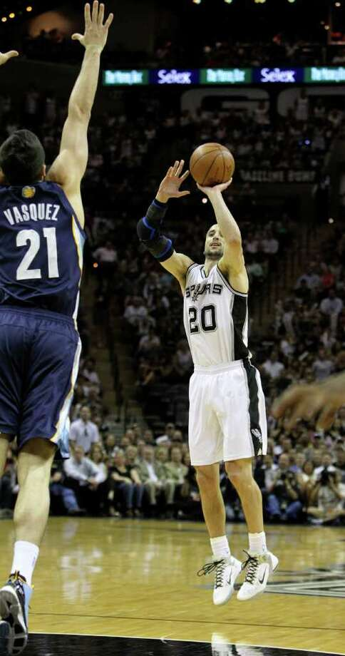San Antonio Spurs guard Manu Ginobili (20) shoots a three point basket against  Memphis Grizzlies guard Greivis Vasquez (21) in Game 5 of the first round of the Western Conference playoff at the AT&T Center on Wednesday, April 27, 2011. Kin Man Hui/kmhui@express-news.net Photo: KIN MAN HUI, Kin Man Hui/kmhui@express-news.net / San Antonio Express-News NFS