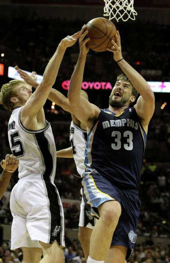 Memphis Grizzlies center Marc Gasol (33) shoots over San Antonio Spurs forward Matt Bonner (15)  in Game 5 of the first round of the Western Conference playoff at the AT&T Center on Wednesday, April 27, 2011. Kin Man Hui/kmhui@express-news.net Photo: KIN MAN HUI, Kin Man Hui/kmhui@express-news.net / San Antonio Express-News NFS