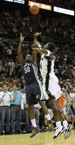 Memphis Grizzlies forward Zach Randolph (50) makes a shot late in the game against San Antonio Spurs forward Antonio McDyess (34) in Game 5 of the first round of the Western Conference playoff at the AT&T Center on Wednesday, April 27, 2011. Kin Man Hui/kmhui@express-news.net Photo: KIN MAN HUI, Kin Man Hui/kmhui@express-news.net / San Antonio Express-News NFS