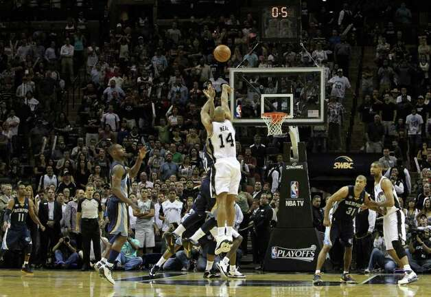 San Antonio Spurs guard Gary Neal (14) hits a game tying shot against the Memphis Grizzlies in Game 5 of the first round of the Western Conference playoff at the AT&T Center on Wednesday, April 27, 2011. Kin Man Hui/kmhui@express-news.net Photo: KIN MAN HUI, Kin Man Hui/kmhui@express-news.net / San Antonio Express-News NFS