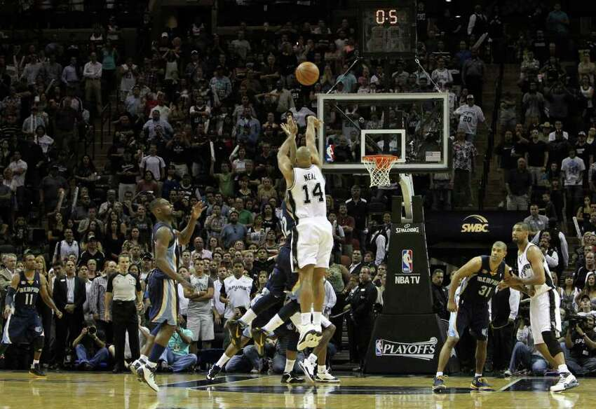 San Antonio Spurs guard Gary Neal (14) hits a game tying shot against the Memphis Grizzlies in Game 5 of the first round of the Western Conference playoff at the AT&T Center on Wednesday, April 27, 2011. Kin Man Hui/kmhui@express-news.net
