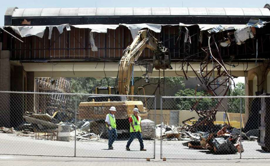 Currently, the entrance way to the Convention Center offices is being demolished to make way for more parking. Photo: Bob Owen/Express-News / rowen@express-news.net