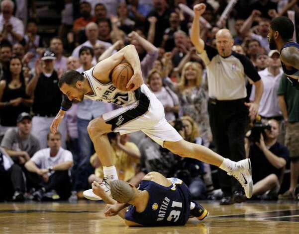 SPURS -- San Antonio Spurs guard Manu Ginobili (20) runs over top of  Memphis Grizzlies forward Shane Battier (31) after being fouled by Battier during overtime of game five of the Western Conference First Round at AT&T Center, Wednesday, April 27, 2011.  The Spurs won 110-103.  JERRY LARA/glara@express-news.net Photo: JERRY LARA, JERRY LARA/glara@express-news.net / SAN ANTONIO EXPRESS-NEWS (NFS)