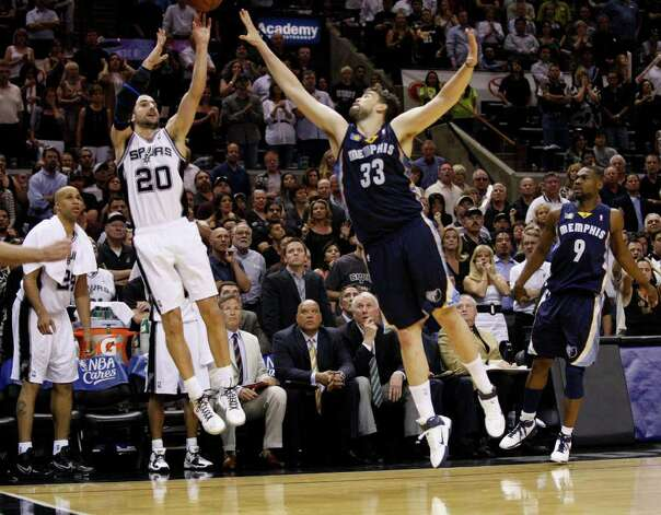 SPURS -- San Antonio Spurs guard Manu Ginobili (20) hits a two point basket, which was reviewed, against  Memphis Grizzlies center Marc Gasol (33) during the second half of game five of the Western Conference First Round at AT&T Center, Wednesday, April 27, 2011. JERRY LARA/glara@express-news.net Photo: JERRY LARA, JERRY LARA/glara@express-news.net / SAN ANTONIO EXPRESS-NEWS (NFS)