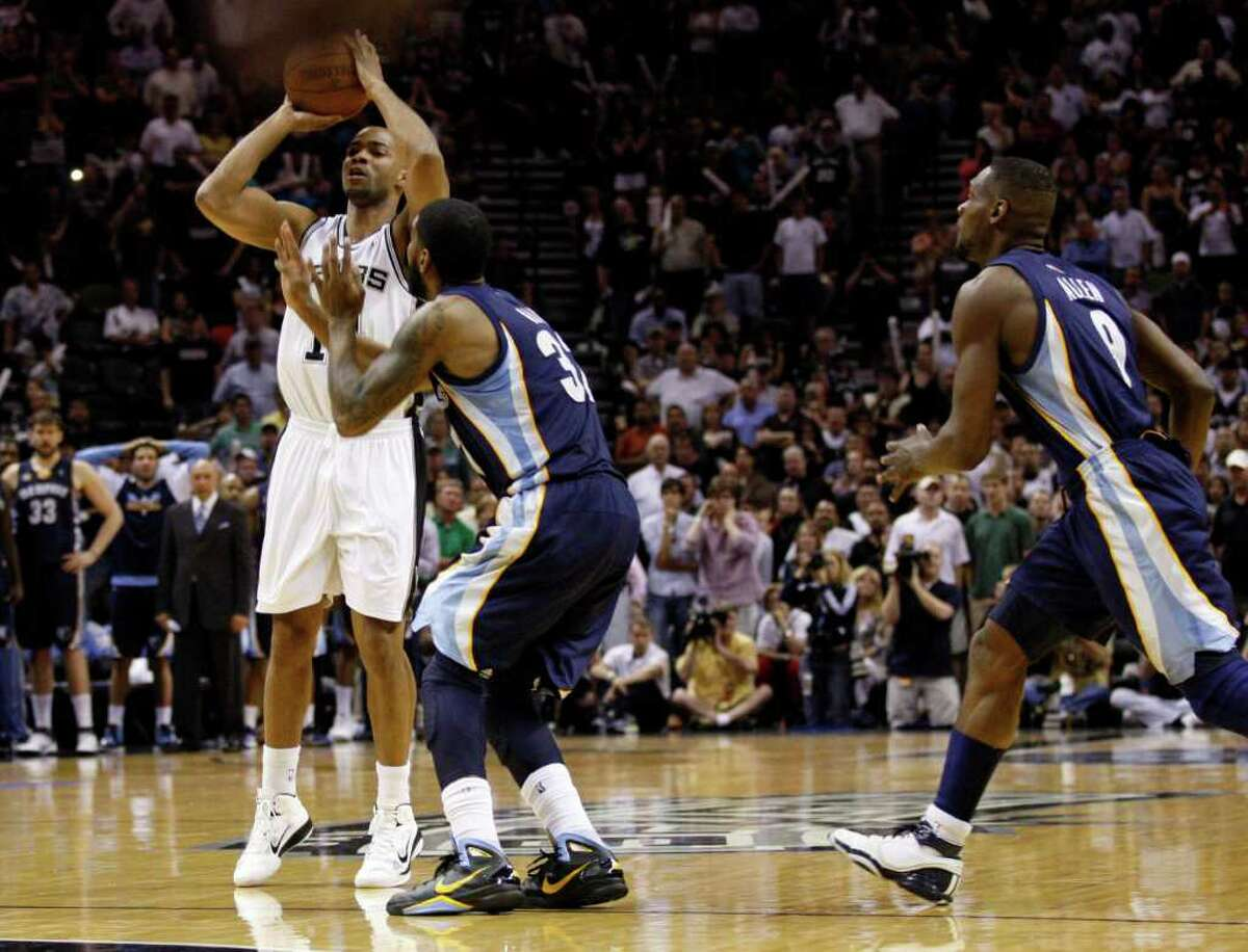 SPURS -- San Antonio Spurs guard Gary Neal (14) hits a game tying shot against Memphis Grizzlies guard O.J. Mayo (32) and Memphis Grizzlies guard Tony Allen (9) during the second half of game five of the Western Conference First Round at AT&T Center, Wednesday, April 27, 2011. JERRY LARA/glara@express-news.net