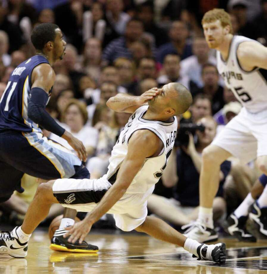 SPURS -- San Antonio Spurs guard Tony Parker (9) reacts after contact near  Memphis Grizzlies guard Mike Conley (11) and San Antonio Spurs forward Matt Bonner (15) during the second half of game five of the Western Conference First Round at AT&T Center, Wednesday, April 27, 2011. JERRY LARA/glara@express-news.net Photo: JERRY LARA, JERRY LARA/glara@express-news.net / SAN ANTONIO EXPRESS-NEWS (NFS)