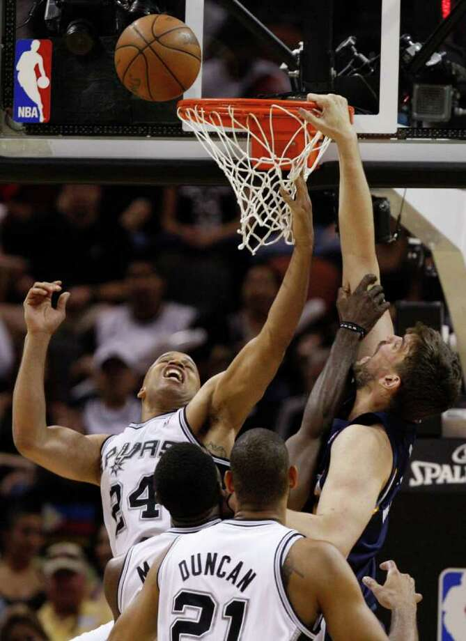 SPURS --  Memphis Grizzlies center Marc Gasol (33) tries to dunk against San Antonio Spurs forward Richard Jefferson (24) during the second half of game five of the Western Conference First Round at AT&T Center, Wednesday, April 27, 2011. JERRY LARA/glara@express-news.net Photo: JERRY LARA, JERRY LARA/glara@express-news.net / SAN ANTONIO EXPRESS-NEWS (NFS)