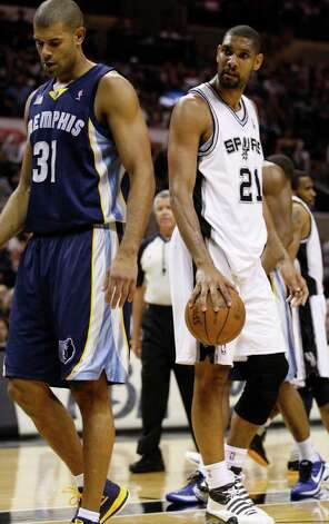 SPURS -- San Antonio Spurs forward Tim Duncan (21) stares down  Memphis Grizzlies forward Shane Battier (31) during the first half of game five of the Western Conference First Round at AT&T Center, Wednesday, April 27, 2011. JERRY LARA/glara@express-news.net Photo: JERRY LARA, JERRY LARA/glara@express-news.net / SAN ANTONIO EXPRESS-NEWS (NFS)