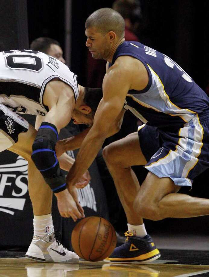 SPURS -- San Antonio Spurs guard Manu Ginobili (20) and  Memphis Grizzlies forward Shane Battier (31) fight for a loose ball during the first half of game five of the Western Conference First Round at AT&T Center, Wednesday, April 27, 2011. JERRY LARA/glara@express-news.net Photo: JERRY LARA, JERRY LARA/glara@express-news.net / SAN ANTONIO EXPRESS-NEWS (NFS)