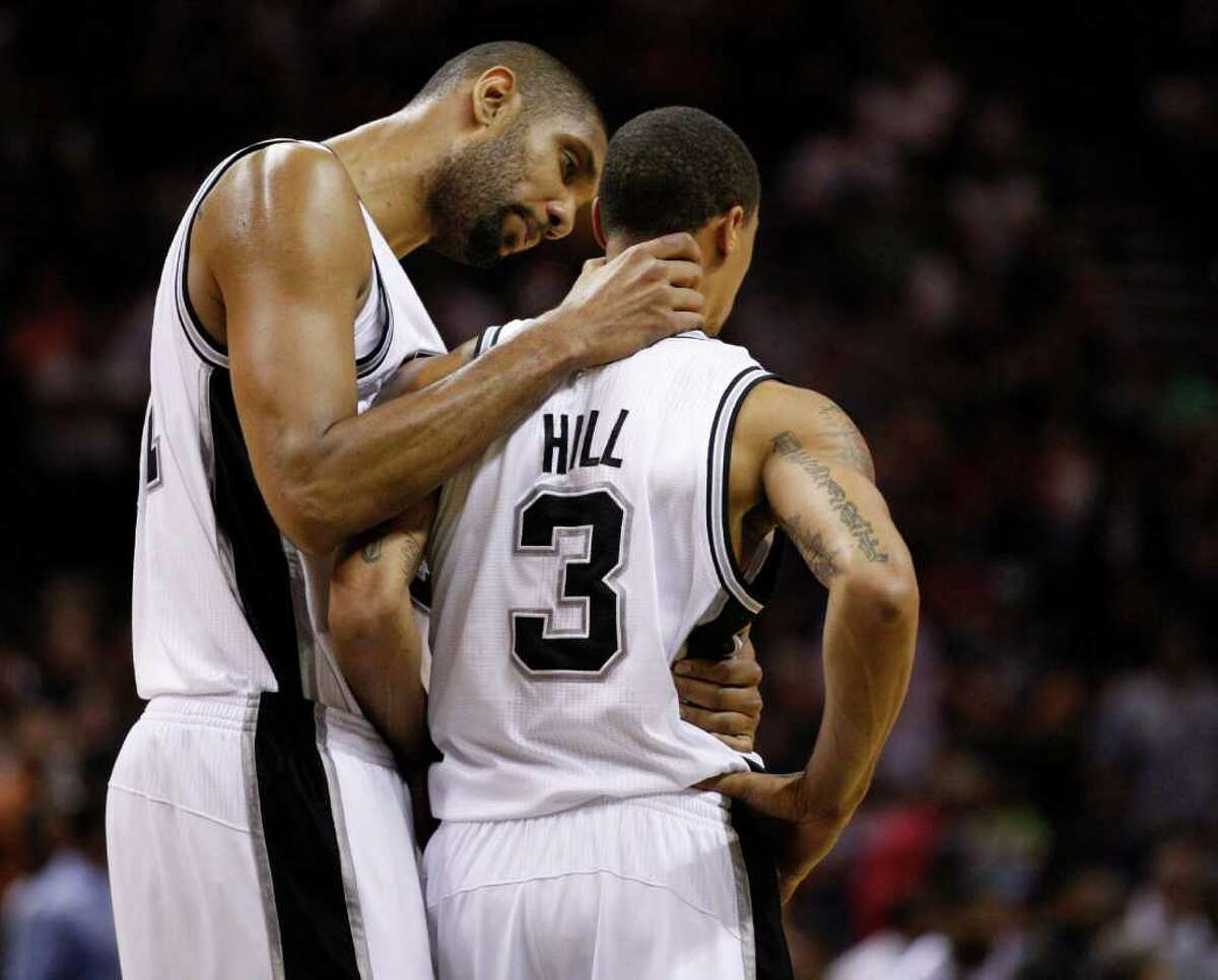 SPURS -- San Antonio Spurs forward Tim Duncan (21) has a word with San Antonio Spurs guard George Hill (3) near the end of the first half of game five of the Western Conference First Round at AT&T Center, Wednesday, April 27, 2011. JERRY LARA/glara@express-news.net