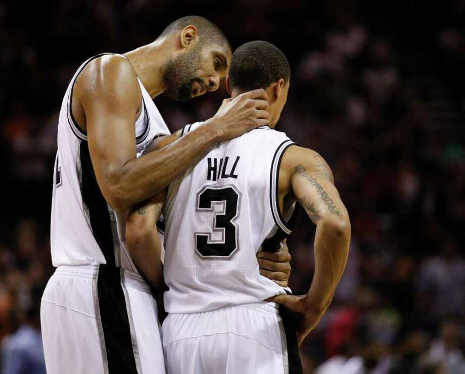 SPURS -- San Antonio Spurs forward Tim Duncan (21) has a word with San Antonio Spurs guard George Hill (3) near the end of the first half of game five of the Western Conference First Round at AT&T Center, Wednesday, April 27, 2011. JERRY LARA/glara@express-news.net Photo: JERRY LARA, JERRY LARA/glara@express-news.net / SAN ANTONIO EXPRESS-NEWS (NFS)