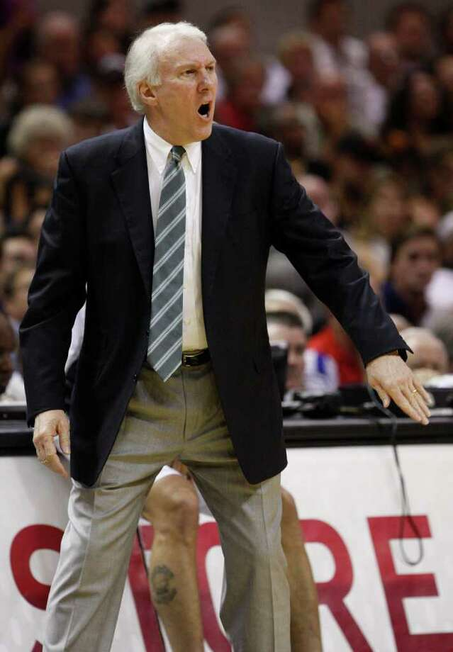 SPURS -- San Antonio coach Gregg Popovich gestures against the Memphis Grizzlies during the first half of game five of the Western Conference First Round at AT&T Center, Wednesday, April 27, 2011. JERRY LARA/glara@express-news.net Photo: JERRY LARA, JERRY LARA/glara@express-news.net / SAN ANTONIO EXPRESS-NEWS (NFS)