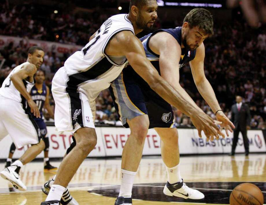 SPURS -- San Antonio Spurs forward Tim Duncan (21) and  Memphis Grizzlies center Marc Gasol (33) fight for a loose ball during the first half of game five of the Western Conference First Round at AT&T Center, Wednesday, April 27, 2011. JERRY LARA/glara@express-news.net Photo: JERRY LARA, JERRY LARA/glara@express-news.net / SAN ANTONIO EXPRESS-NEWS (NFS)