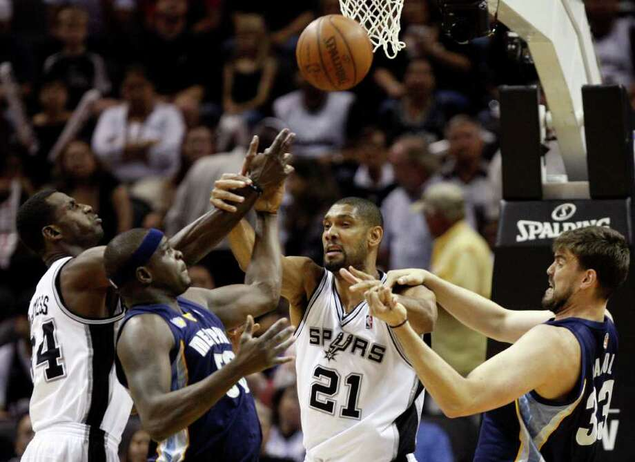 SPURS -- San Antonio Spurs forward Antonio McDyess (34),  Memphis Grizzlies forward Zach Randolph (50), San Antonio Spurs forward Tim Duncan (21) and  Memphis Grizzlies center Marc Gasol (33) fight for a rebound during the first half of game five of the Western Conference First Round at AT&T Center, Wednesday, April 27, 2011. JERRY LARA/glara@express-news.net Photo: JERRY LARA, JERRY LARA/glara@express-news.net / SAN ANTONIO EXPRESS-NEWS (NFS)