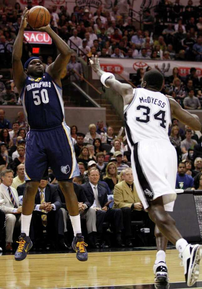 SPURS --  Memphis Grizzlies forward Zach Randolph (50) shoots over San Antonio Spurs forward Antonio McDyess (34) during the first half of game five of the Western Conference First Round at AT&T Center, Wednesday, April 27, 2011. JERRY LARA/glara@express-news.net Photo: JERRY LARA, JERRY LARA/glara@express-news.net / SAN ANTONIO EXPRESS-NEWS (NFS)