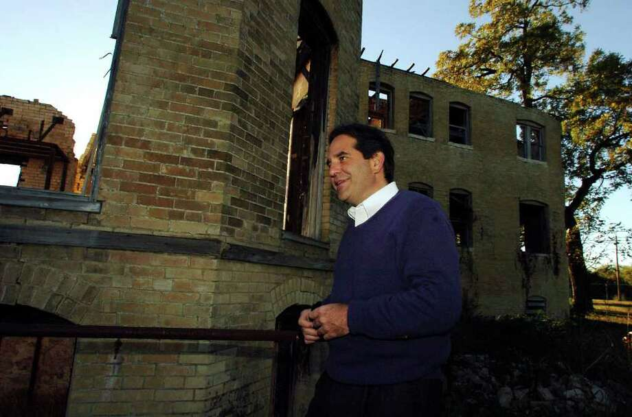 Owner James Lifshutz tours the South Side ruins of the once-acclaimed Hot Wells resort. Dating to the 1890s, it was last open in 1977. Photo: BILLY CALZADA, SAN ANTONIO EXPRESS-NEWS / SAN ANTONIO EXPRESS-NEWS
