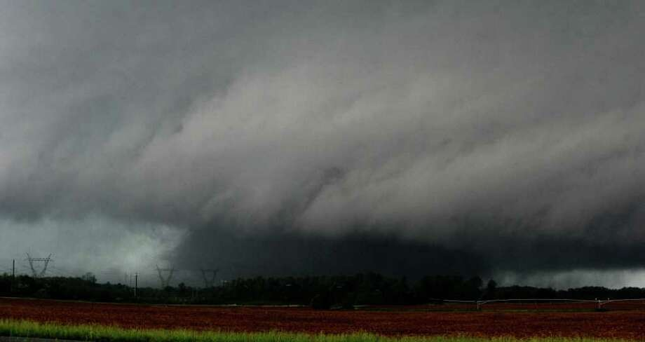 A large tornado sweeps through Limestone County, south of Athens, Ala., near Stewart Road on Wednesday. Photo: AP