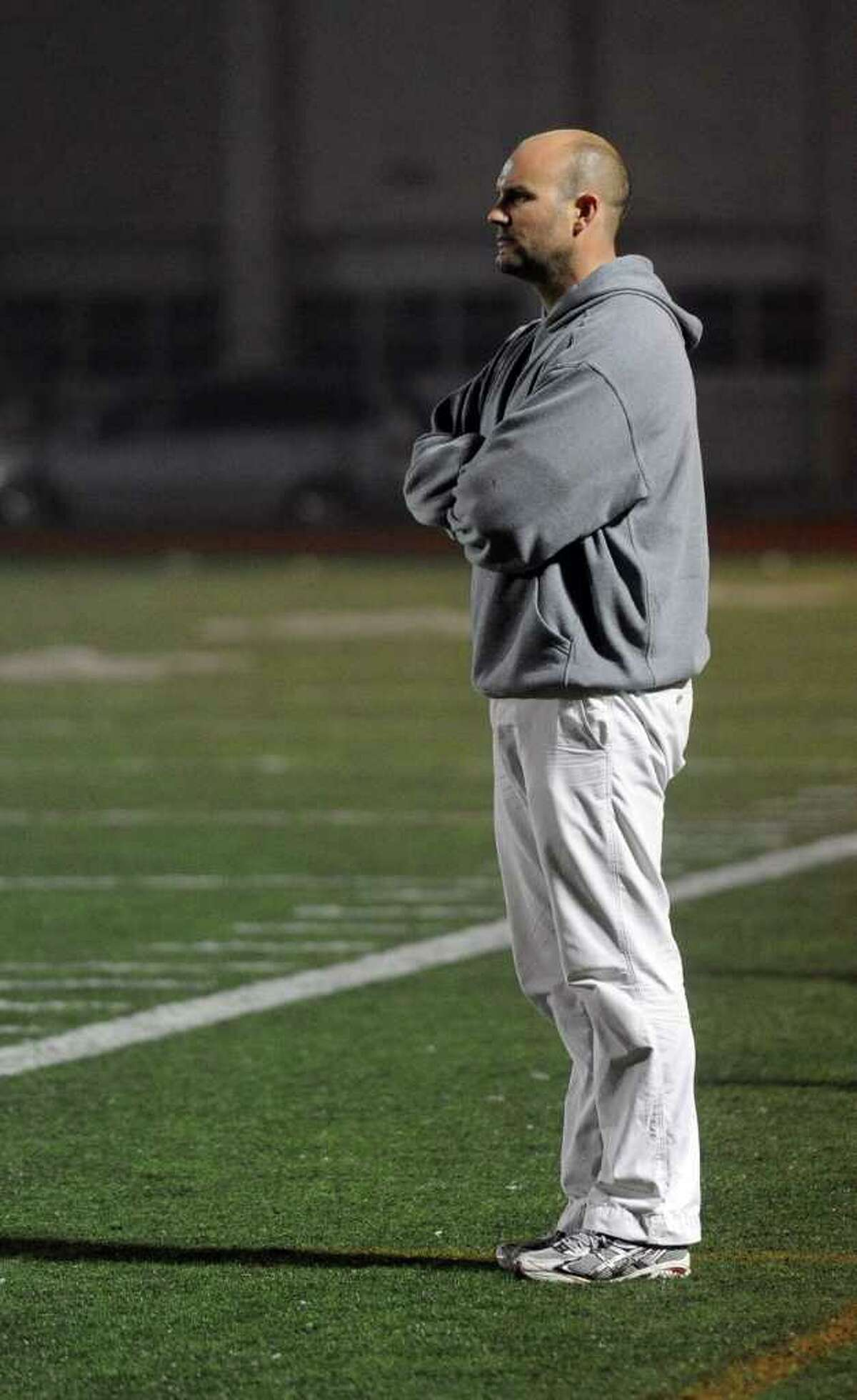 New Canaan coach Alex Whitten watches his team during Wednesday's lacrosse game against New Canaan at Fairfield Ludlowe High School on April 27, 2011.