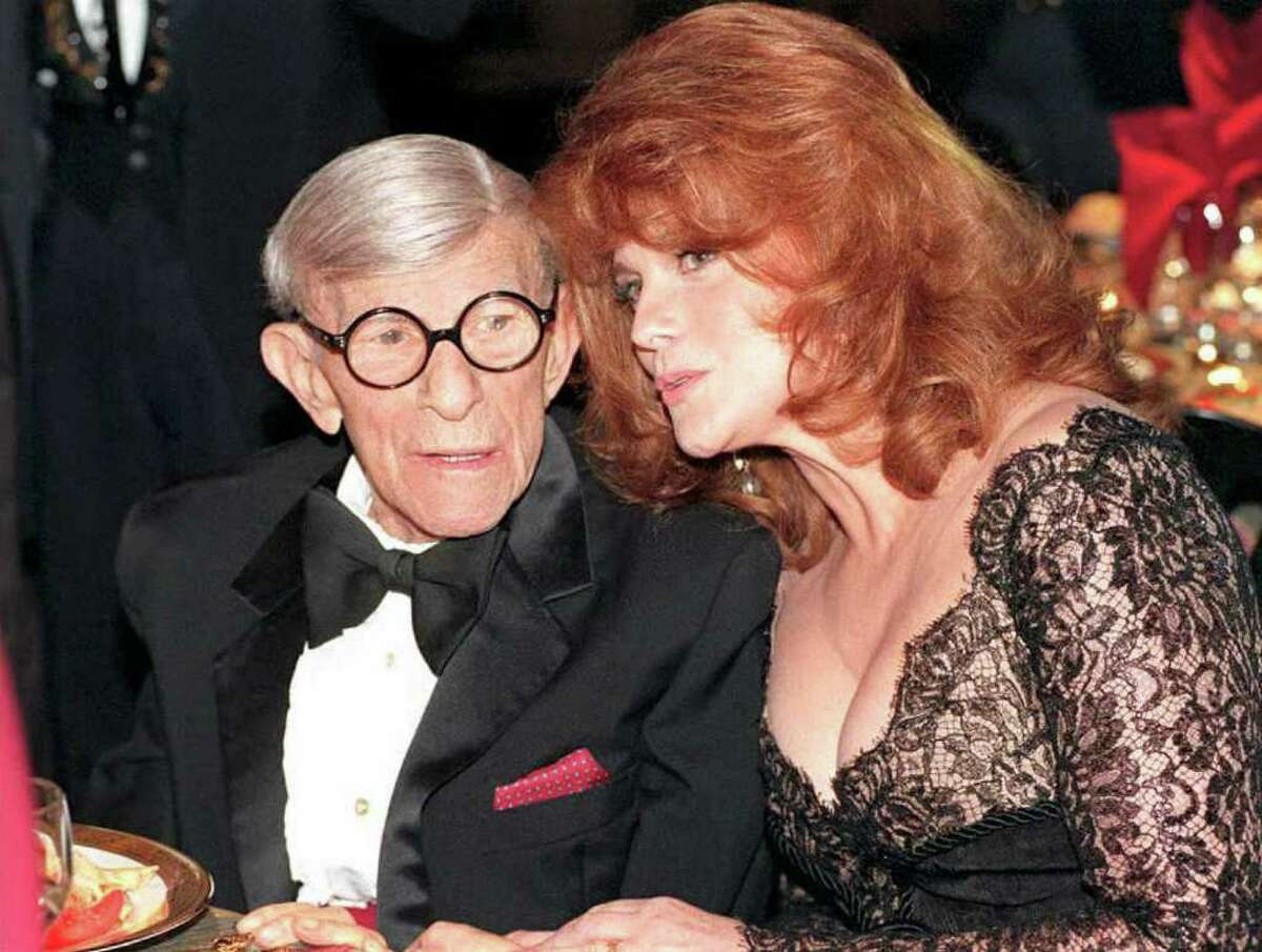 US entertainer George Burns (L) talks with actress Ann Margret during the Inaugural Screen Actors Guild Awards Show 25 February in Los Angeles. Margaret later presented Burns with a lifetime achievement award for his many years as a screen performer. (COLOR KEY: Burns has red hankerchief in pocket) AFP PHOTO
