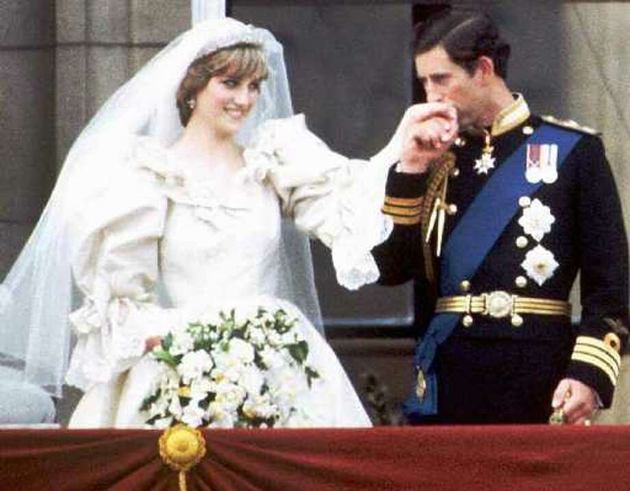 FILE--Britain's Prince Charles kisses Princess Diana on the balcony of Buckingham Palace in London after their wedding, in this July 29, 1981 file photo. Diana, who had been struggling to build a new public and private life after her turbulent divorce, was killed Sunday, Aug. 31, 1997, along with her companion, Dodi Fayed, in a car crash as their Mercedes was being pursued by photographers. (AP Photo/FILE)