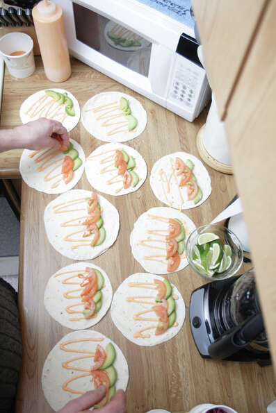 Chef Patrick Longton arranges the avocado slices for his fish tacos. (Suzanne Kawola/Life@Home) Clic