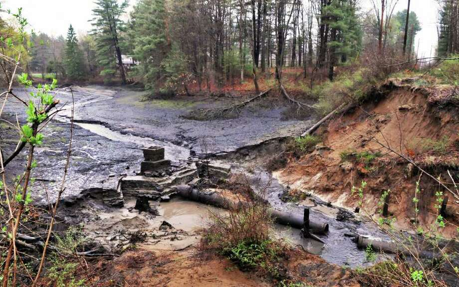 Failed earthen dam at a pond on Rt. 9 at Brower Rd. in Saratoga Springs Thursday April 28, 2011.  (John Carl D'Annibale / Times Union) Photo: John Carl D'Annibale