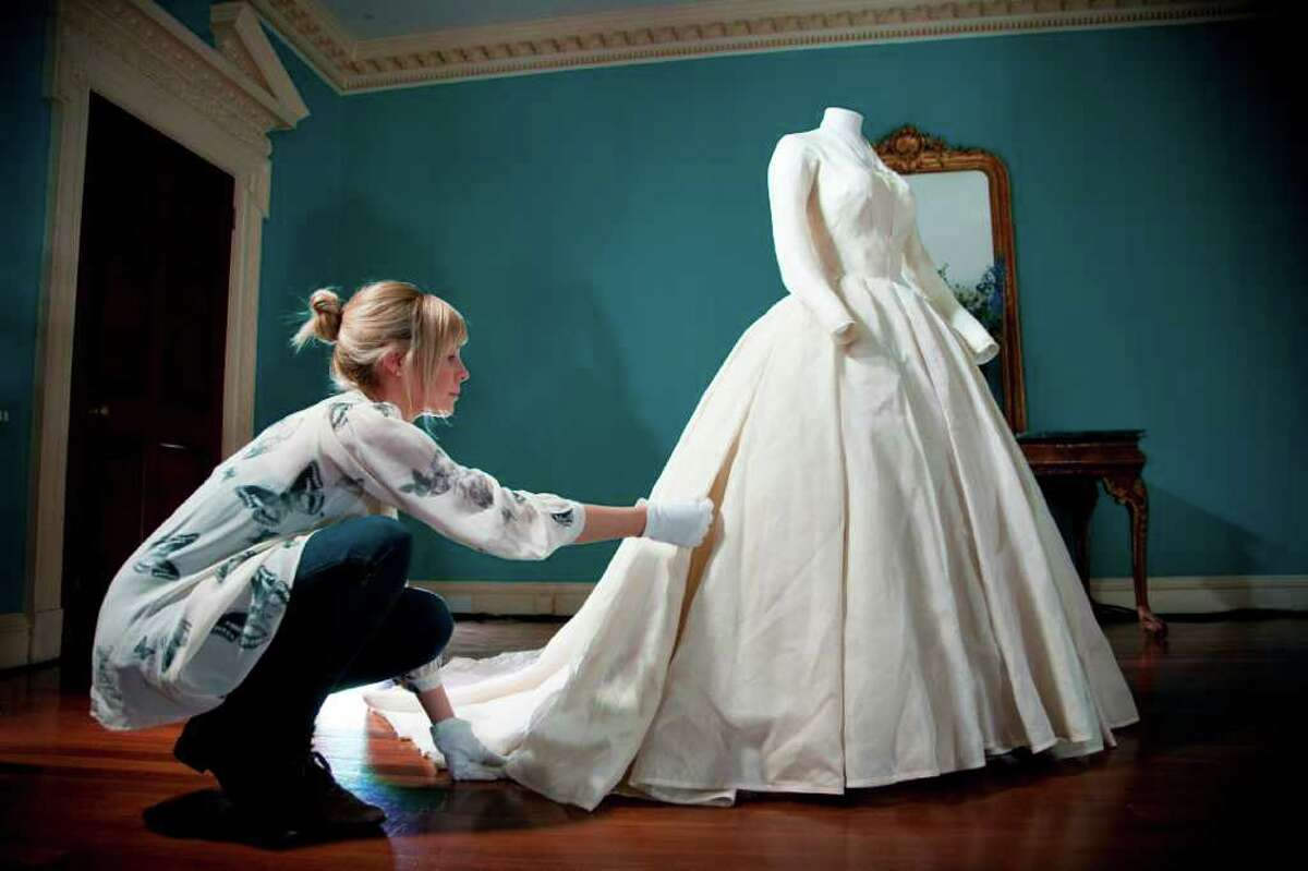 In this undated photo released by the Royal Collection on Thursday April 21 2011, a conservator puts finishing touches to the simple but stunning wedding dress worn by HRH Princess Margaret when she married Lord Snowdon in 1960. The glamorous dress comprised a fitted bodice and a full skirt of fine diaphanous silk. As speculation continues as to the design of Catherine Middleton?'s wedding dress, a precious collection of historic royal wedding dresses worn by royal brides over the last 200 years have just undergone over 1000 hours of conservation treatment by conservators from Britain's Historic Royal Palaces. The wedding dresses belonging to Princess Charlotte (1816), Queen Victoria (1840), Alexandra of Denmark (1863), Princess Mary of Teck (1893), Princess Margaret (1960) and Princess Alexandra of Kent (1963) are usually carefully stored at Kensington Palace but have been made available to the media and are viewable on the Historic Royal Palaces website. (AP Photo/The Royal Collection/Historic Royal Palaces) MANDATORY CREDIT. NO ARCHIVE NO SALES. SINGLE USE AND IN RELATION TO THE ROYAL WEDDING ONLY