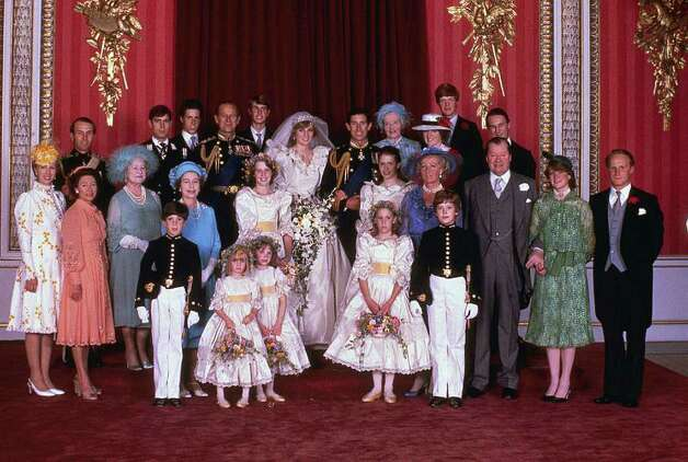 FILE - In this July 29, 1981 file photo, Princess Diana and Prince Charles, center, as they pose with family and guests on their wedding day in London. The biggest fashion faux pas for a wedding guest _ to any wedding _ would be to upstage the bride. The attire worn to a British royal wedding is appropriate daytime wedding attire kicked up many, many notches, Sally Kilbridge, deputy editor of Brides magazine says. Everyone's outfit should be chic, elegant and suit the very formal, traditional occasion while not letting glitzy, black-tie, eveningwear trappings creep in, she advises.   (AP Photo/File)