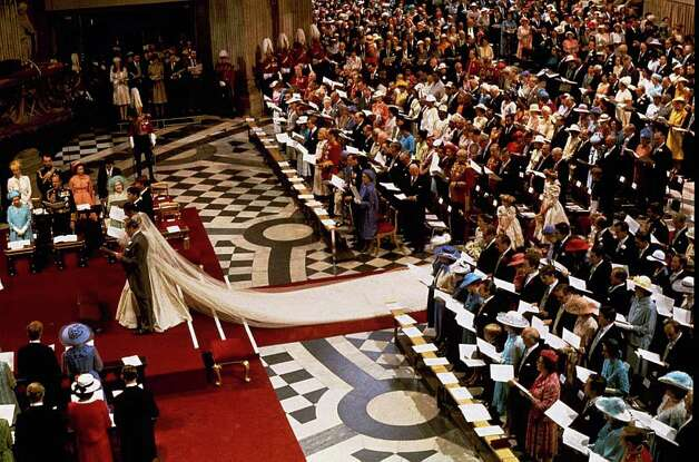 FILE - In this July 29, 1981 file photo, the wedding ceremony of Princess Diana and Prince Charles is seen at St. Paul's Cathedral in London. The biggest fashion faux pas for a wedding guest _ to any wedding _ would be to upstage the bride. The attire worn to a British royal wedding is appropriate daytime wedding attire kicked up many, many notches, Sally Kilbridge, deputy editor of Brides magazine says. Everyone's outfit should be chic, elegant and suit the very formal, traditional occasion while not letting glitzy, black-tie, eveningwear trappings creep in, she advises.    (AP Photo/File)