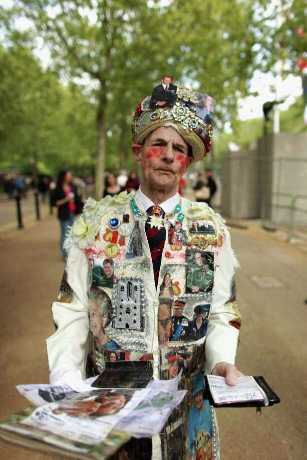 LONDON, ENGLAND - APRIL 28:  Royal family fan William Willis walks along the Mall wearing a suit covered in images of Prince William, Catherine Middleton and other members of the royal family on April 28, 2011 in London, England. With less than 24 hours to go final preparations for the wedding of Prince William and Catherine Middleton are in place.  (Photo by Oli Scarff/Getty Images) *** Local Caption *** William Willis; Photo: Getty Images