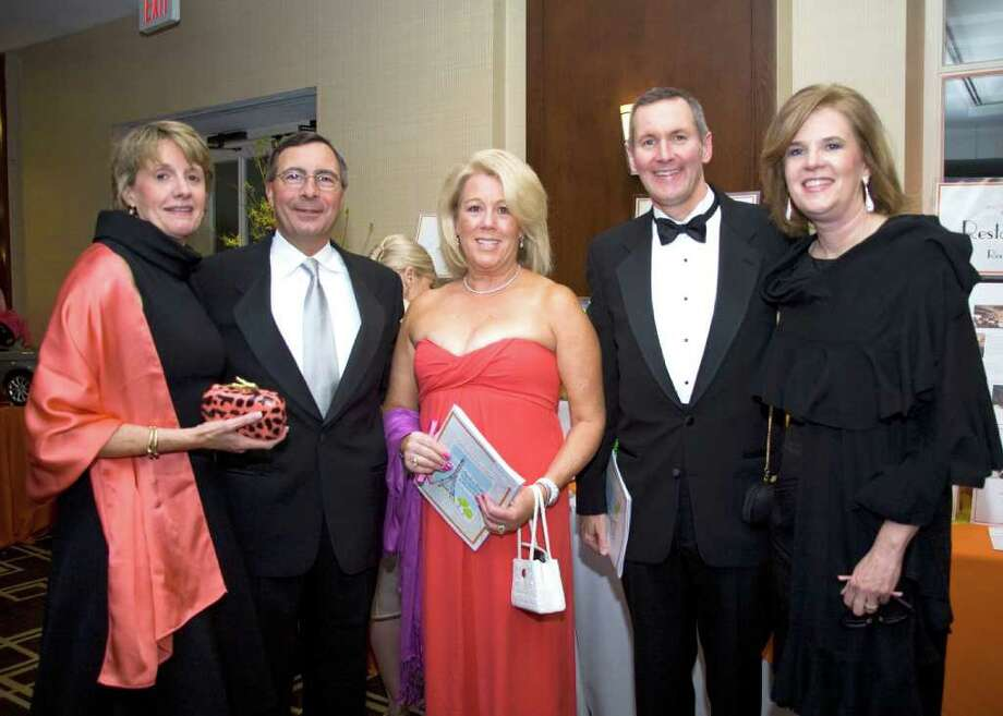 "YWCA Board member and Vice Chair Events Lorraine Gordon, left, is joined at the YWCA's recent Persimmon Ball fundraiser ""April in Paris"" by Perrin Arturi, YWCA Board member and Secretary Susan Arturi, and Kevin and Barbara Clark. Photo: Contributed Photo / Greenwich Citizen"