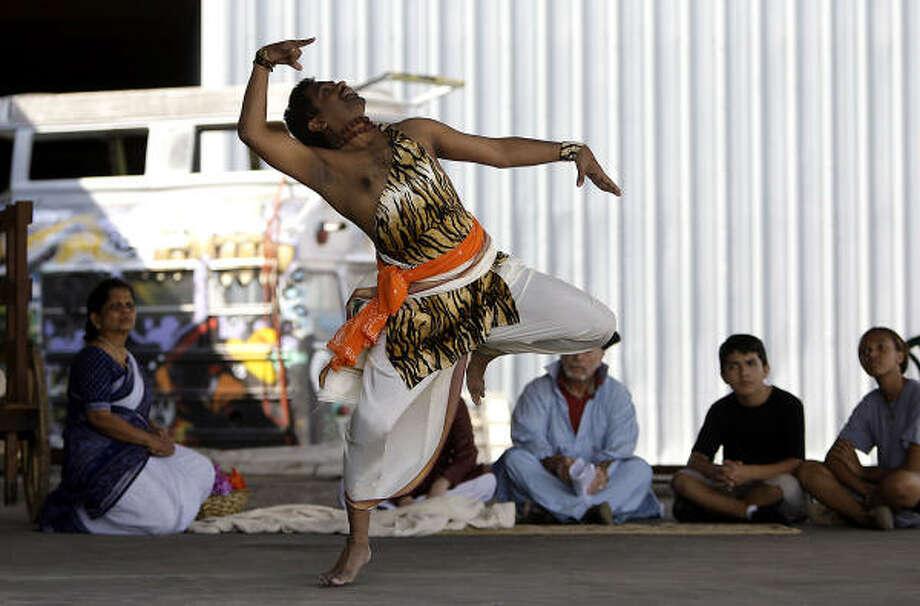"Satya Narendrula dances the Shiva Tandava dance during the dress rehearsal of ""Silk Road Dance."" Photo: Karen Warren, Chronicle"