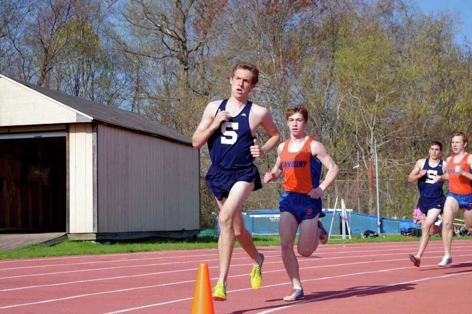 Staples sophomore Henry Wynne ran a leg for two winning relay teams and took second in the mile in helping the Wreckers split a home tri-meet with Danbury and Bassick Tuesday. Photo: Julia Friedman For The Westport News