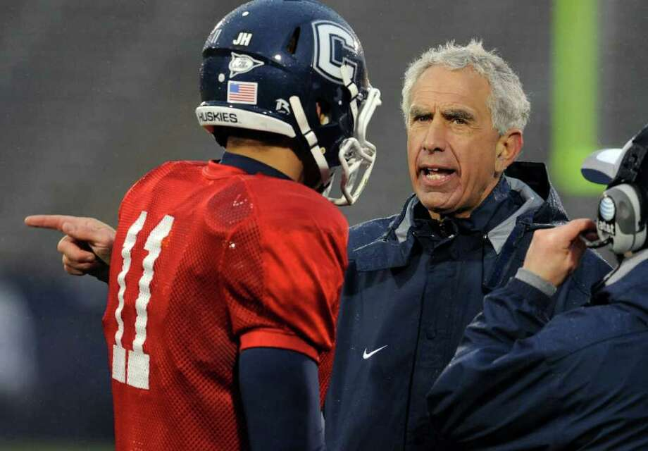 Connecticut head coach Paul Pasqualoni, right, talks with quarterback Scott McCummings, left, during the first half of the UConn Blue vs. White Spring NCAA college football game in East Hartford, Conn., Saturday, April 16, 2011. (AP Photo/Jessica Hill) Photo: AP