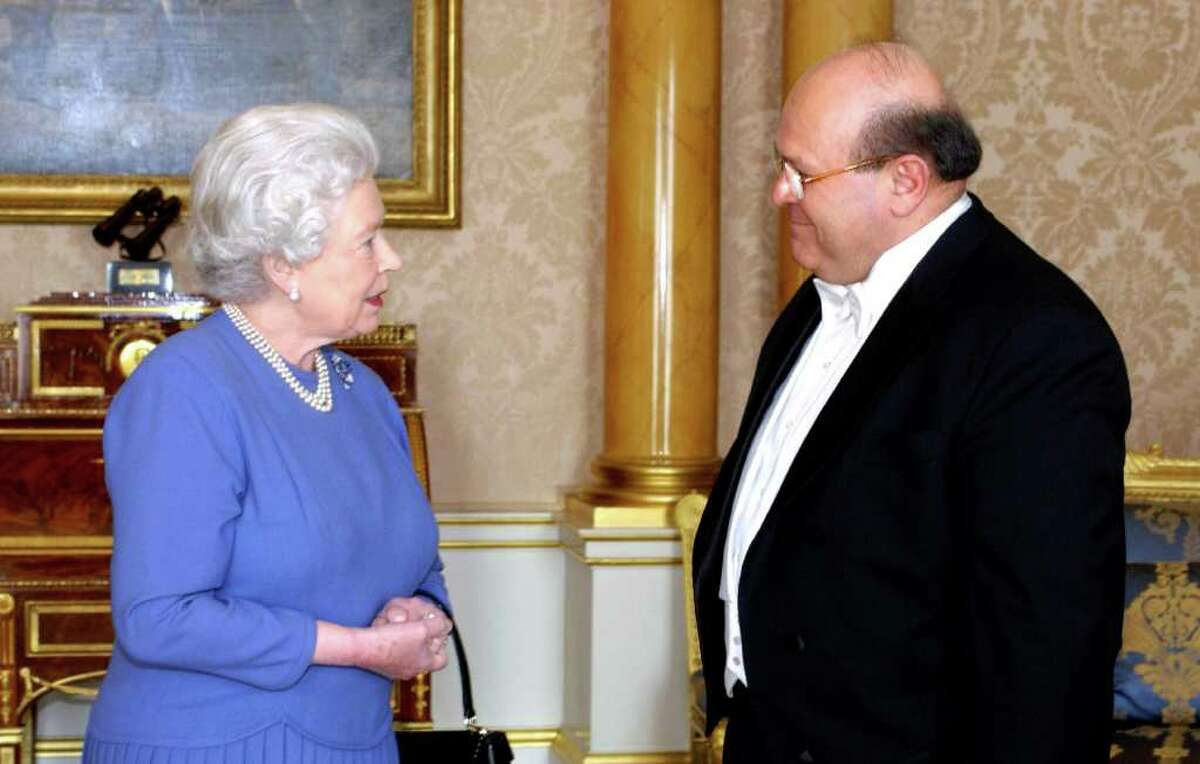 """FILE - This is a March 3, 2005 file photo of Queen Elizabeth II receives the Ambassador of Syria, Sami Khiyami, at Buckingham Palace, London. It wouldn't be a wedding without an argument over the guest list. Human rights groups are criticizing the decision to invite Syria's ambassador Sami Khiyami to Prince William and Kate Middleton's nuptials while his government wages a violent crackdown against opponents. More than 450 people have been killed in the uprising against President Bashar Assad's authoritarian regime. The government said Thursday that ambassadors from all countries with which Britain has """"normal diplomatic relations"""" have been invited some 185 in all. (AP Photo/ Fiona Hanson/Pool)"""