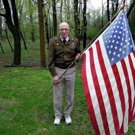 World War II veteran George Williams at his home in Niskayuna, NY Thursday April 28,2011.Williams, a WWII veteran, and others will share their memories of the notorious Concentration Camp Dachau at the state Military History Museum in Saratoga Springs at 2 p.m. Fri. on the 66th anniversary of the camp's liberation by division Soldiers on April 29. The hour-long commemoration precedes this weekend's global Holocaust Remembrance Day, Yom Hashoah, on Sunday, May 1.( Michael P. Farrell/Times Union ) Photo: Michael P. Farrell / 00012950A