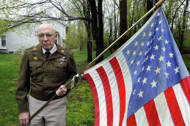 World War II veteran George Williams at his home in Niskayuna, NY Thursday April 28,2011.Williams, a WWII veteran, and others will share their memories of the notorious Concentration Camp Dachau at the state Military History Museum in Saratoga Springs at 2 p.m. Fri. on the 66th anniversary of the camp's liberation by division Soldiers on April 29. The hour-long commemoration precedes this weekend's global Holocaust Remembrance Day, Yom Hashoah, on Sunday, May 1.( Michael P. Farrell/Times Union ) Photo: Michael P. Farrell