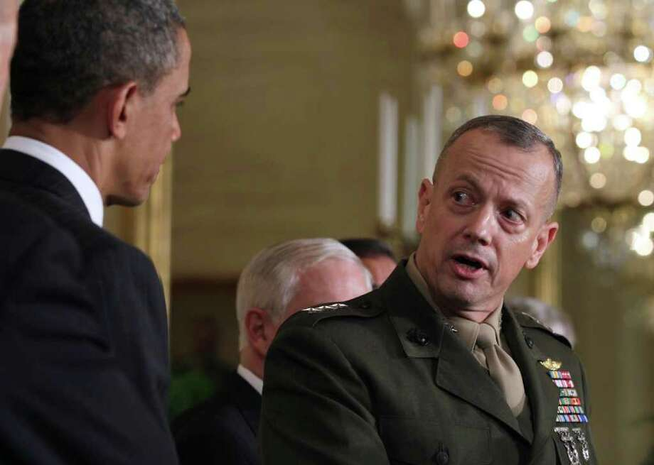 Marine Corps Lt. Gen. John Allen, President Barack Obama's choice to replace Gen. David Petraeus, looks toward the president during a news conference in the East Room of the White House in Washington, Thursday, April 28, 2011.  (AP Photo/Carolyn Kaster) Photo: Carolyn Kaster