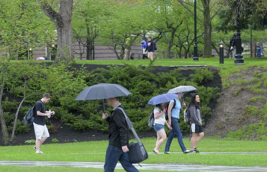 Students make their way in the rain between classes on the RPI campus on Thursday afternoon, April 28, 2011, in Troy.   (Paul Buckowski / Times Union) Photo: Paul Buckowski / 00012975A