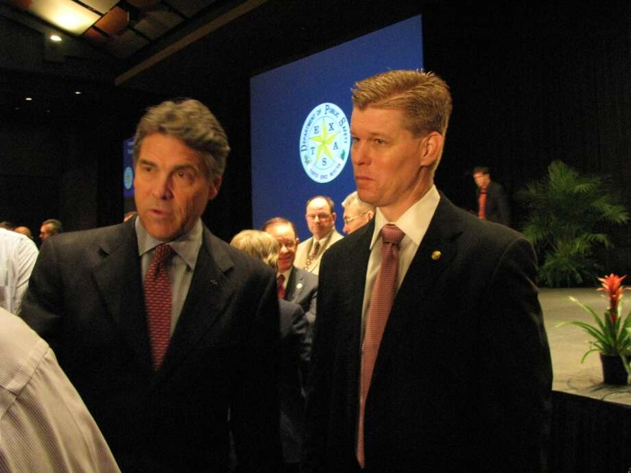 Gov. Rick Perry (left) and emergency management official Nim Kidd answer questions after the conference's general session. Photo: Courtesy Of Nicole Murray/Texas DPS / COURTESY TX DPS
