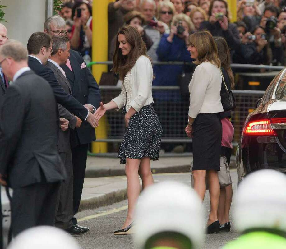 Kate Middleton, centre and her mother Carole, centre right and sister Pippa, partially seen, are greeted upon arrival  at the Goring Hotel in London, Thursday April 28, 2011, ahead of her wedding to Britain's Prince William on Friday April 29.  (AP Photo/Joel Ryan) Photo: Joel Ryan / AP