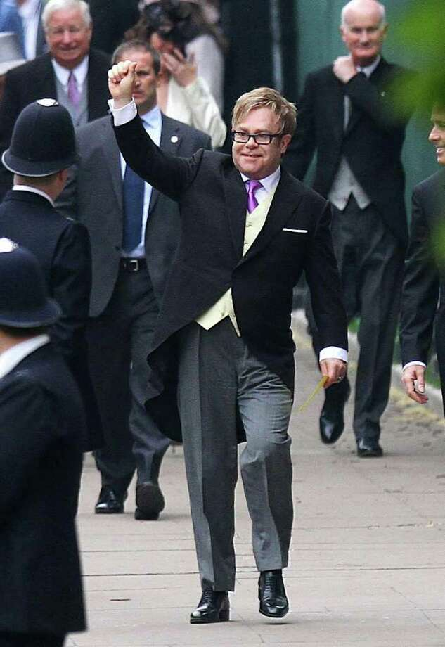 Musician Elton John arrives at Westminster Abbey, London, for the wedding of Britain's Prince William and Kate Middleton Friday April 29, 2011.  UNITED KINGDOM OUT Photo: Gareth Fuller / PA
